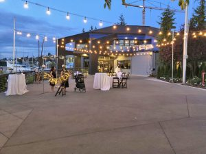 Evening Dockside Patio Venue with Lighting