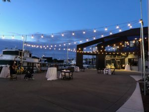 Evening Dockside Patio Lighting Against Blue Nighttime Sky