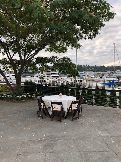 Outdoor Dockside Dining Table on Patio with Background Boats